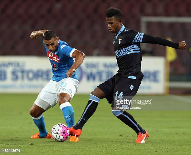 Faouzi Ghoulam of Napoli competes for the ball with Keita of Lazio during the Serie A match between SSC Napoli and SS Lazio at Stadio San Paolo on...