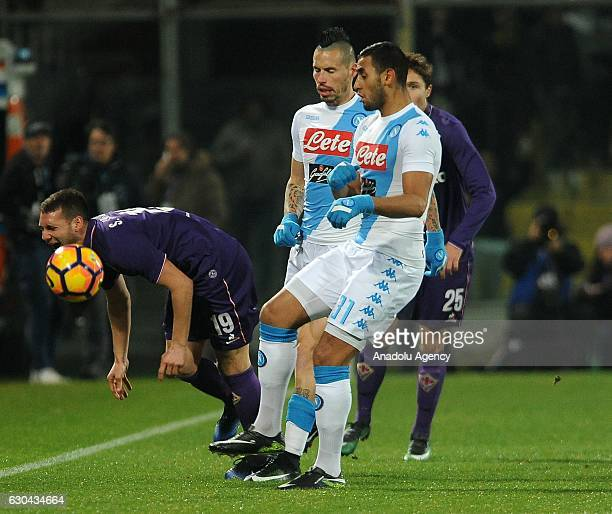 Faouzi Ghoulam of Napoli in action against Sebastian Cristoforo of Acf Fiorentina during the Italian Serie A soccer match between ACF Fiorentina and...