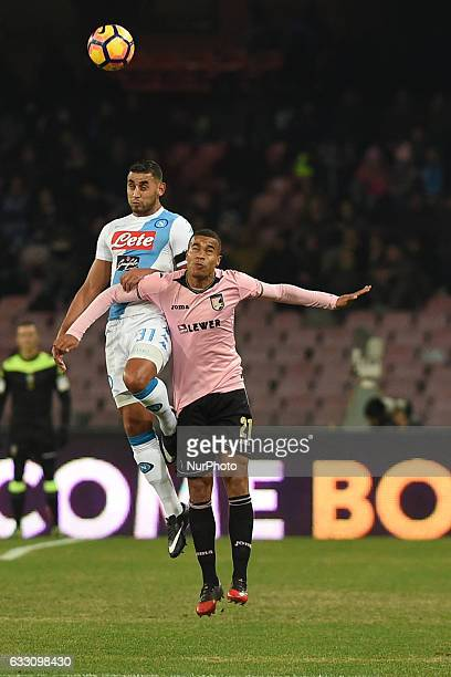 Faouzi Ghoulam of SSC Napoli competes for the ball with US Citta di Palermo player Robin Quaison during the Serie A TIM match between SSC Napoli and...