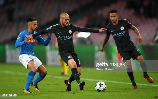 Faouzi Ghoulam of SSC Napoli puts pressure on David Silva of Manchester City during the UEFA Champions League group F match between SSC Napoli and...