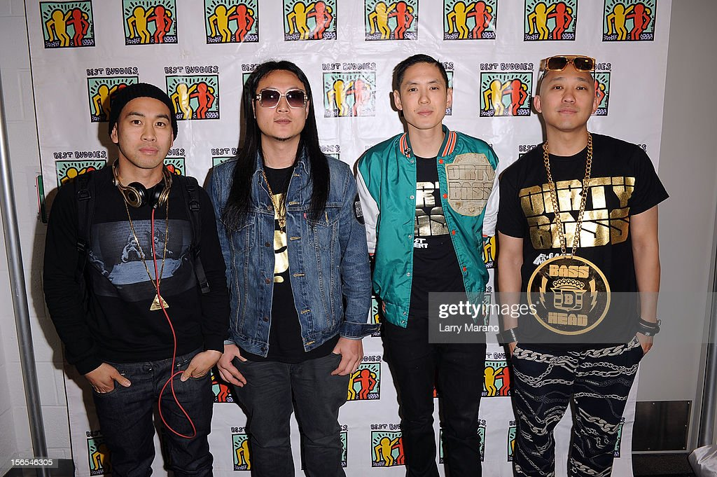 Far East Movement bandmembers DJ Virman, J-Splif, Kev Nish and Prohgress pose backstage at the Best Buddies Bash Featuring Far East Movement and SkyBlu of LMFAO at Marlins Park on November 16, 2012 in Miami, Florida.