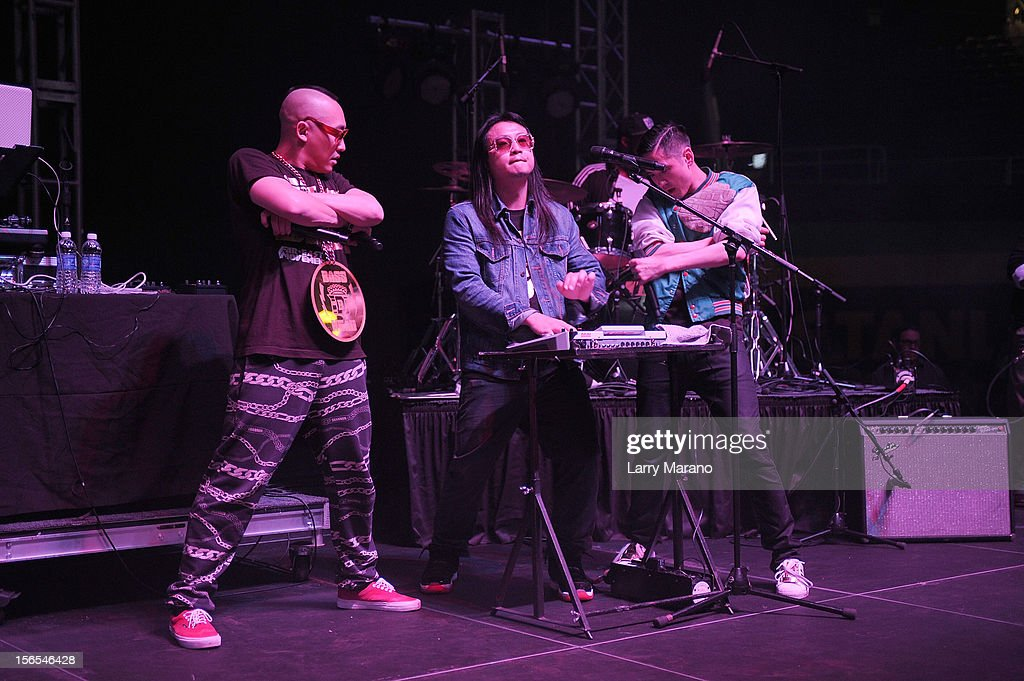 Far East Movement bandmembers Prohgress, <a gi-track='captionPersonalityLinkClicked' href=/galleries/search?phrase=J-Splif&family=editorial&specificpeople=7240612 ng-click='$event.stopPropagation()'>J-Splif</a> and <a gi-track='captionPersonalityLinkClicked' href=/galleries/search?phrase=Kev+Nish&family=editorial&specificpeople=7240613 ng-click='$event.stopPropagation()'>Kev Nish</a> perform onstage at the Best Buddies Bash Featuring Far East Movement and SkyBlu of LMFAO at Marlins Park on November 16, 2012 in Miami, Florida.