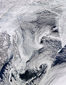 February 16, 2010 - Far eastern Russia covered in snow, ice, and clouds. In the center of the image is the Sea of Okhotsk, the boundaries of which are marked by Sakhalin Island at image center, Japan?