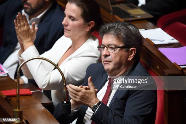 Far left party la France Insoumise deputees JeanLuc Melenchon and Caroline Fiat applaud during a session of questions to the government the National...