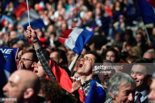 Far right supporters attend a presidential campaign rally by National Front Leader Marine Le Pen at the Zenith Metropole on February 26 2017 in Lyon...
