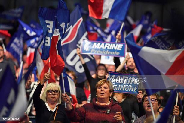 Far right supporters attend a presidential campaign rally by National Front Leader Marine Le Pen at the Dome De Marseille on April 19 2017 in...