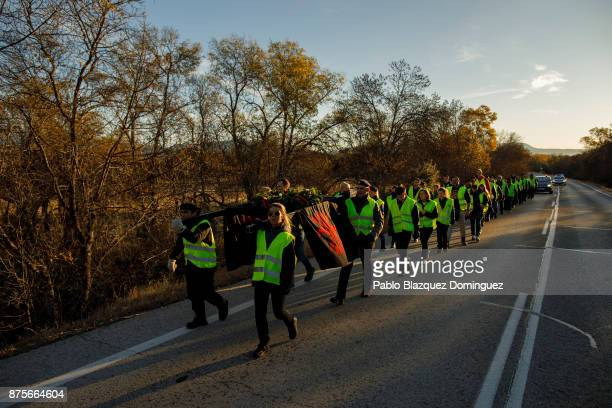 Far right wing supporters approach to the end of their 50 kilometres long walk 'Crown March' to the Valley of the Fallen to commemorate the 81st...