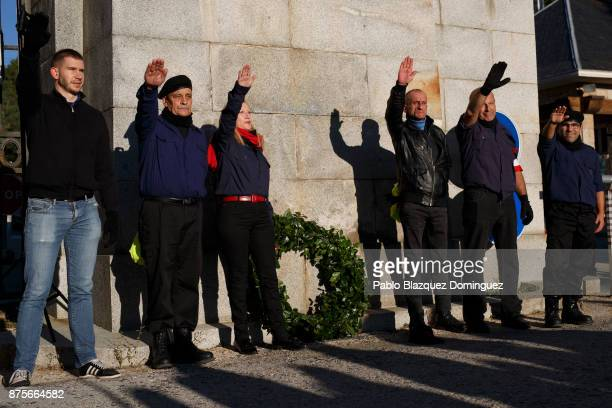 Far right wing supporters do a fascist salute as they pose for a picture next to a Laurel wreath at the end of the 'Crown March' outside the Valley...