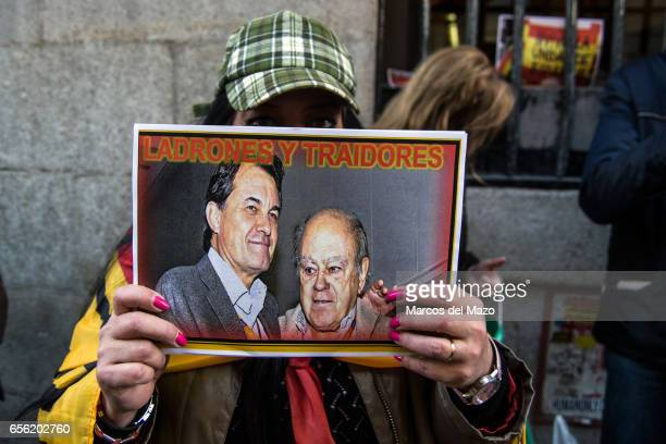 A far right winger protesting a against former Catalan president Artur Mas who held a debate with former Spanish Minister of Foreign Affairs and...