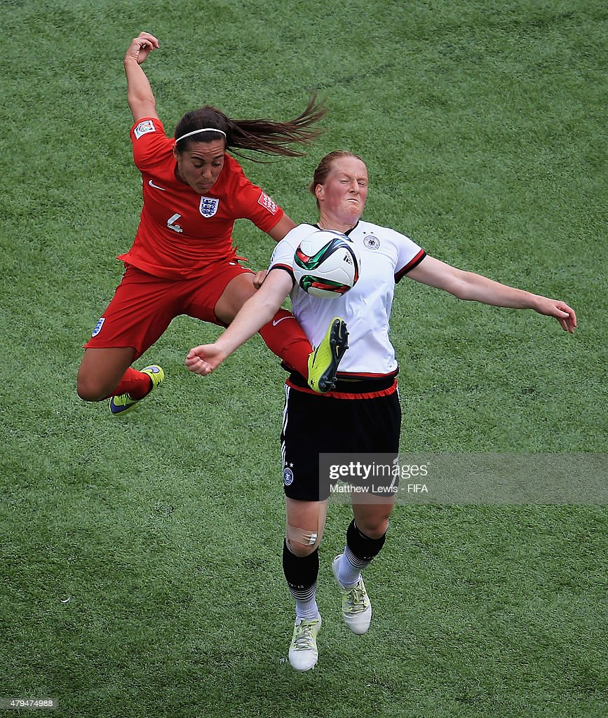 Fara Williams of England and Melanie Behringer of Germany challenge for the ball during the FIFA Women's World Cup 2015 Third Place Play-off match between Germany and England at Commonwealth Stadium on July 4, 2015 in Edmonton, Canada.