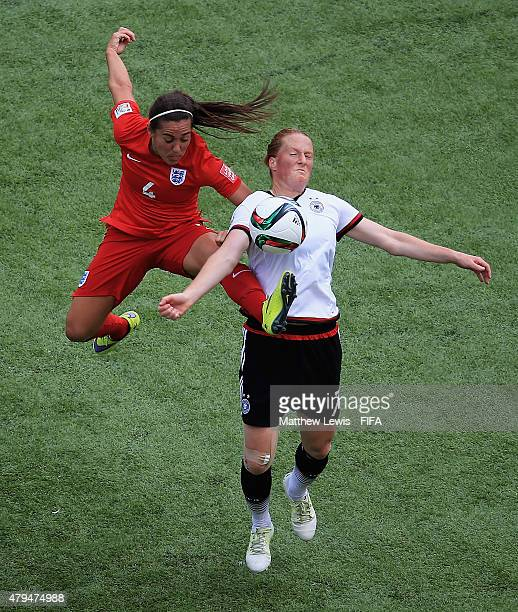 Fara Williams of England and Melanie Behringer of Germany challenge for the ball during the FIFA Women's World Cup 2015 Third Place Playoff match...