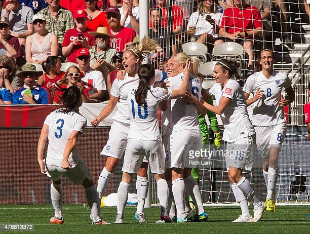 Fara Williams of England celebrates team mate Lucy Bronze's goal against Canada with teammates during the FIFA Women's World Cup Canada 2015 Quarter...