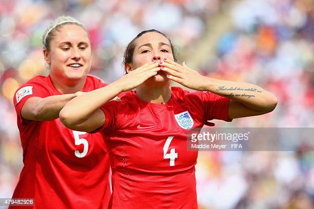 Fara Williams of England celebrates with Steph Houghton after scoring a penalty kick goal during the FIFA Women's World Cup 2015 third place playoff...