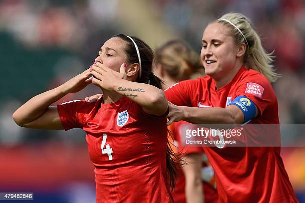 Fara Williams of England celebrates with team mate Steph Houghton as she scores the opening goal from a penalty during the FIFA Women's World Cup...