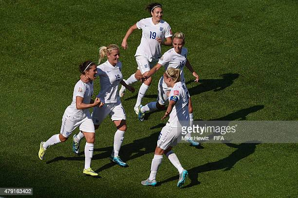 Fara Williams of England celebrates with team mates after equalising during the FIFA Women's World Cup 2015 Semi Final match between Japan and...