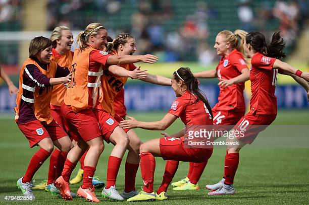 Fara Williams of England celebrates with team mates as she scores the opening goal from a penalty during the FIFA Women's World Cup Canada 2015 Third...