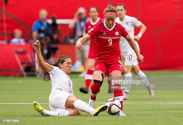 Fara Williams of England delivers a slide tackle to Josee Belanger of Canada during the FIFA Women's World Cup Canada 2015 Quarter Final match...