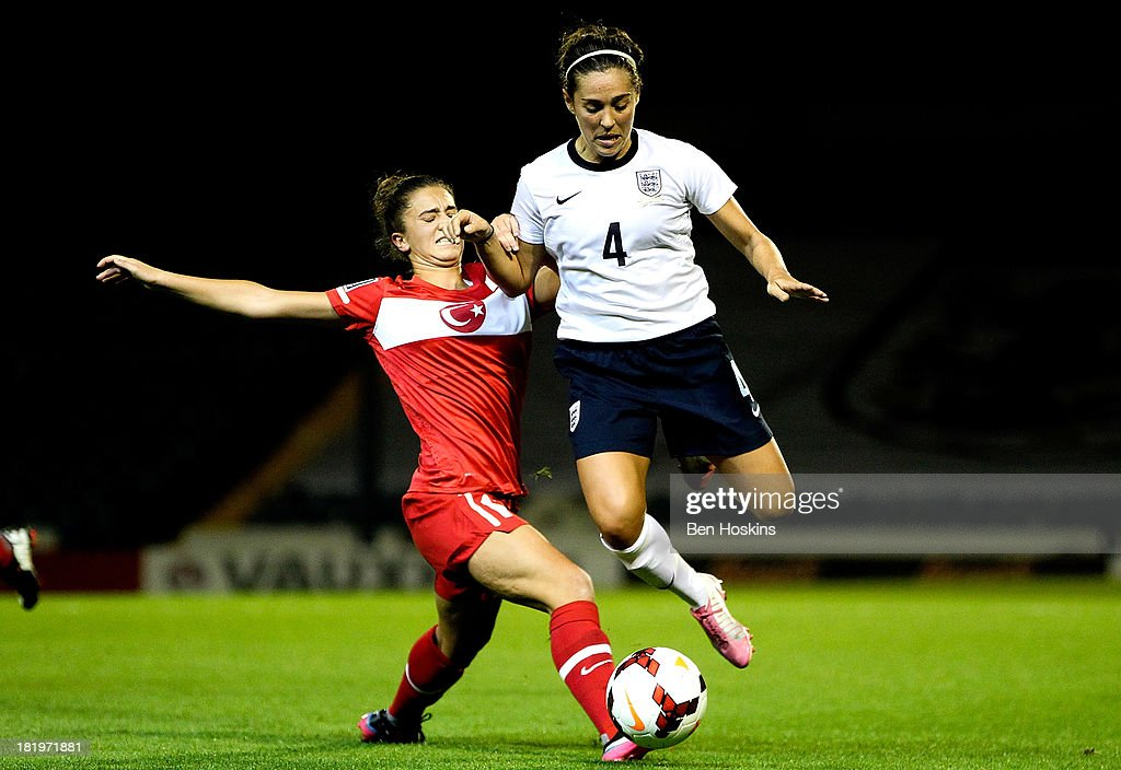 <a gi-track='captionPersonalityLinkClicked' href=/galleries/search?phrase=Fara+Williams&family=editorial&specificpeople=2309371 ng-click='$event.stopPropagation()'>Fara Williams</a> of England skips past the challenge of Emone Ecem Esen of Turkey during the FIFA Women's World Cup 2015 Group 6 Qualifier match between England and Turkey at Fratton Park on September 26, 2013 in Portsmouth, England.