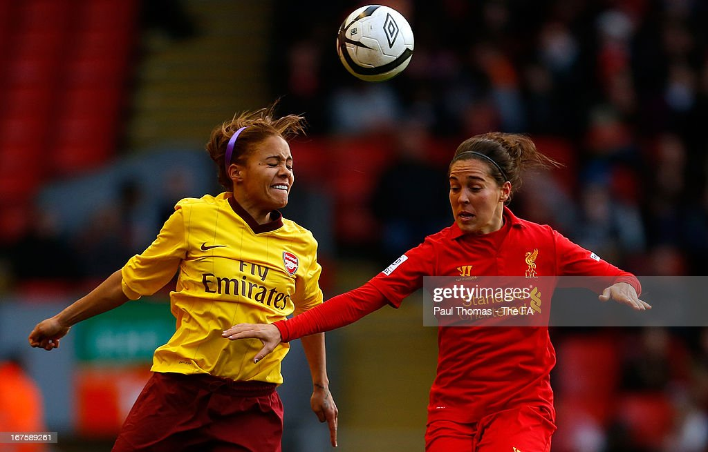 <a gi-track='captionPersonalityLinkClicked' href=/galleries/search?phrase=Fara+Williams&family=editorial&specificpeople=2309371 ng-click='$event.stopPropagation()'>Fara Williams</a> (R) of Liverpool in action with Alex Scott of Arsenal during the Womens FA Cup Semi Final match between Liverpool Ladies FC and Arsenal Ladies FC at Anfield on April 26, 2013 in Liverpool, England.