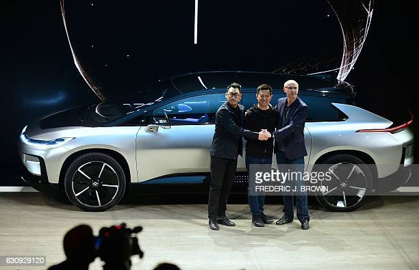 Faraday Future's Richard Kim VP of design YT Jia founder n CEO of LeEco and Faraday Future's Nick Sampson SVP of RD Engineering pose in front of the...