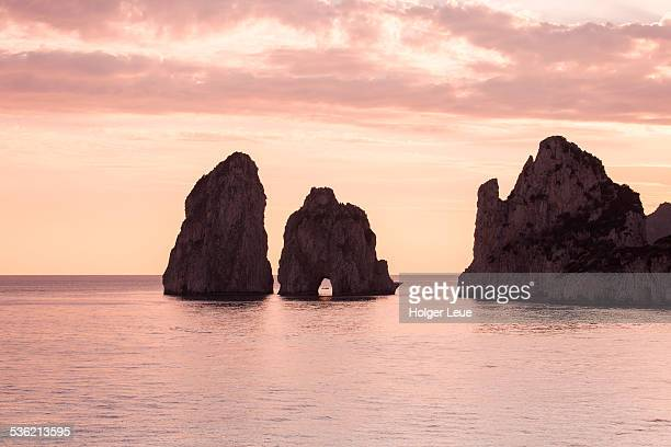 Faraglioni Rocks at sunset