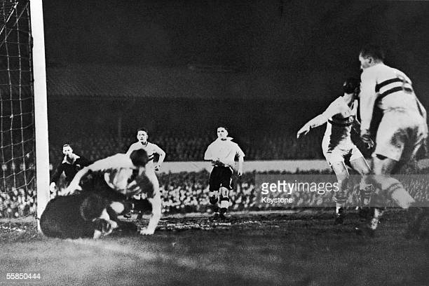 Farago the Hungarian goalkeeper drops the ball by the post taking a Wolverhampton Wanderers forward with him during a match at Molineux 14th December...