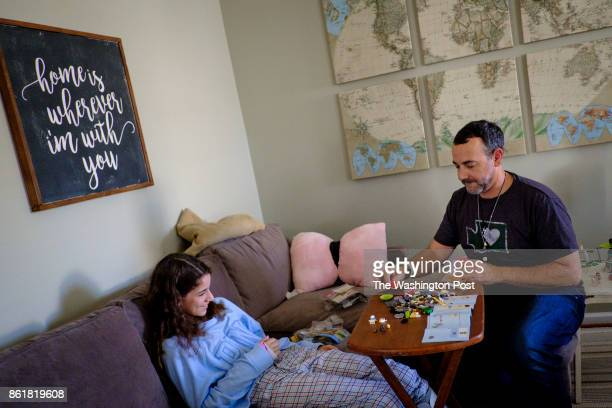 Faran Kaplan assembles Legos with his daughter Emma in their home on Wednesday September 27 2017 in Ashburn Virginia Faran's wife Erin their three...