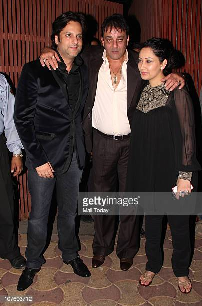 Fardeen Khan with Sanjay and Manyata Dutt at the wedding anniversary celebrations of Fardeen Natasha Khan in Mumbai on December 14 2010