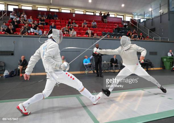 Fares Arfa of Canada fences Abraham Rodriguez of Venezuela during the Team Men's Sabre event on June 18 2017 at the PanAmerican Fencing Championships...