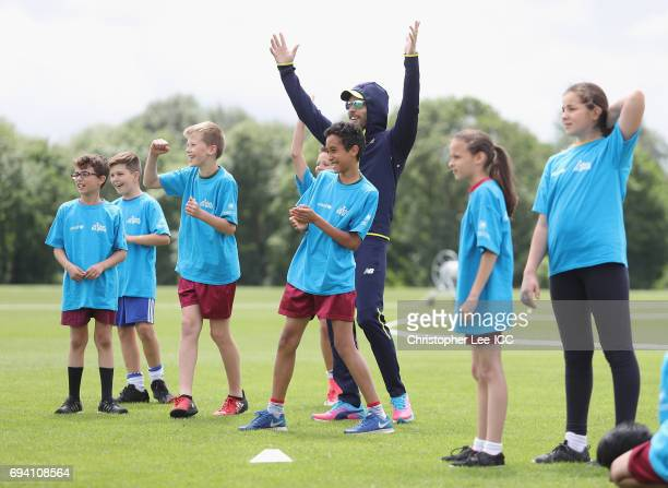 Farhaan Behardien of South Africa celebrates as he plays a cricket game with local kids during the ICC Cricket For Good coaching session with South...