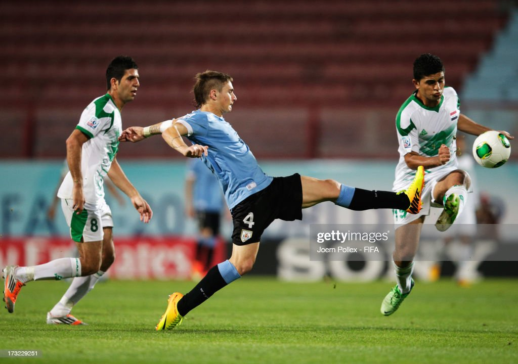 Farhan Shakor (R) of Iraq and Guillermo Varela of Uruguay compete for the ball during the FIFA U-20 World Cup Semi Final match between Iraq and Uruguay at Huseyin Avni Aker Stadium on July 10, 2013 in Trabzon, Turkey.