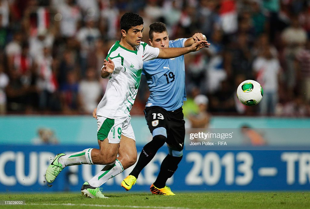 Farhan Shakor (L) of Iraq and Jose Gimenez of Uruguay compete for the ball during the FIFA U-20 World Cup Semi Final match between Iraq and Uruguay at Huseyin Avni Aker Stadium on July 10, 2013 in Trabzon, Turkey.