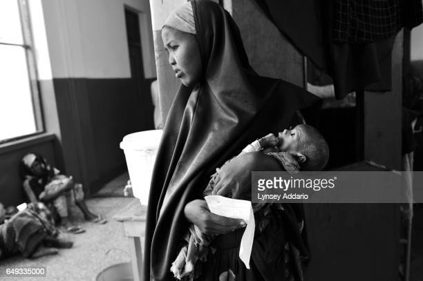 Farhija Ahmed Siyad is seen with her child Warmahan two months at a camp in Mogadishu Somalia on Aug 25 2011