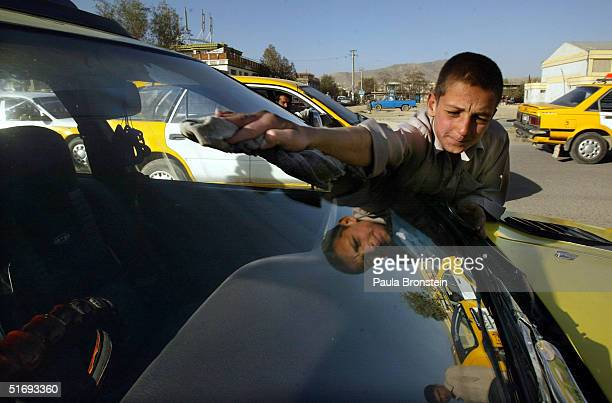 Farid age 12 makes a little money by washing cars November 5 2004 in Kabul Afghanistan The small money he makes helps supplement their family income...