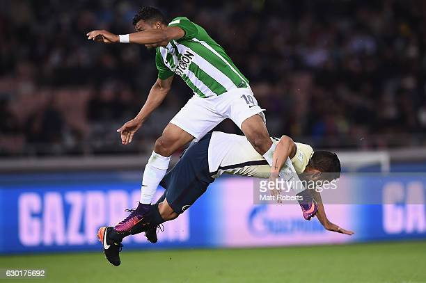 Farid Diaz of Atletico Nacional collides in th air with Miguel Samudio of Club America during the FIFA Club World Cup 3rd place match between Club...