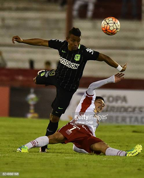 Farid Diaz of Atletico Nacional fights for the ball with Cristian Espinoza of Huracan during a first leg match between Huracan and Atletico Nacional...