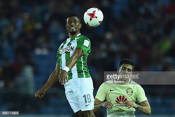 Farid Diaz of Atletico Nacional heads the ball over Ventura Alvarado during the FIFA Club World Cup 3rd place match between Club America and Atletico...