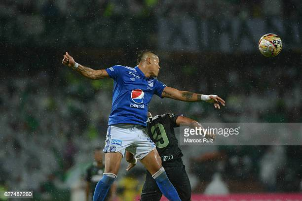 Farid Diaz of Atletico Nacional jumps for the ball with Ayron del Valle of Millonarios during a match between Millonarios and Atletico Nacional as...