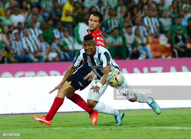 Farid Diaz of Atletico Nacional struggles for the ball with Hernan Hechalar of Independiente Medellin during a second leg match between Atletico...