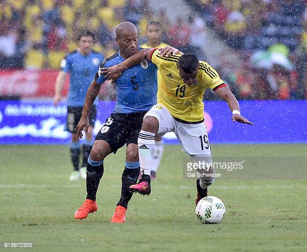 Farid Diaz of Colombia struggles for the ball with Carlos Sanchez of Uruguay during a match between Colombia and Uruguay as part of FIFA 2018 World...