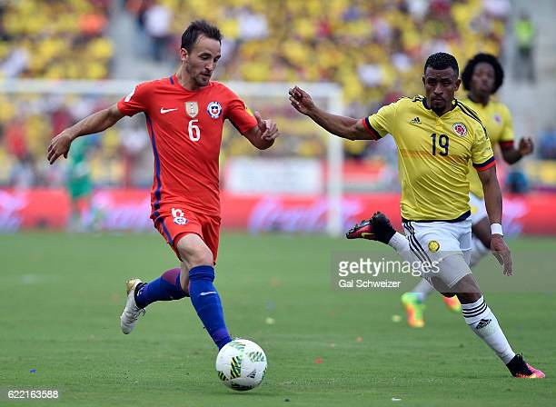 Farid Diaz of Colombia struggles for the ball with Jose Pedro Fuenzalida of Chile during a match between Colombia and Chile as part of FIFA 2018...