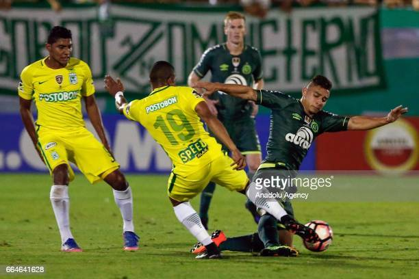 Farid Diaz of Colombia's Atletico Nacional tries control to the ball with Joao Pedro of Brazils Chapecoense during the first leg of the South...