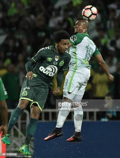 Farid Diaz of Nacional goes for a header with Osman Junior of Chapecoense during a match between Atletico Nacional and Chapecoense as part of...