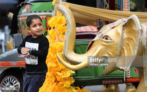 TORONTO ON JULY 23 Farid Khan 4 1/2 keeps an eye on one of the displays Thousands came out to the Festival of South Asia this past weekend on Gerrard...
