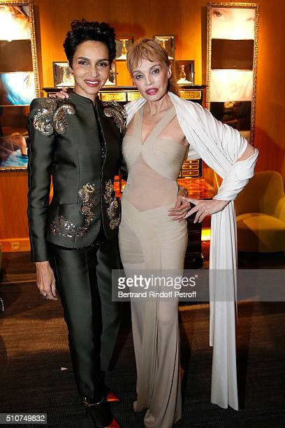 Farida Khelfa and Arielle Dombasle attend Arielle Dombasle presents her Perfume 'Le secret d'Arielle' at Galerie Pierre Passebon on February 16 2016...