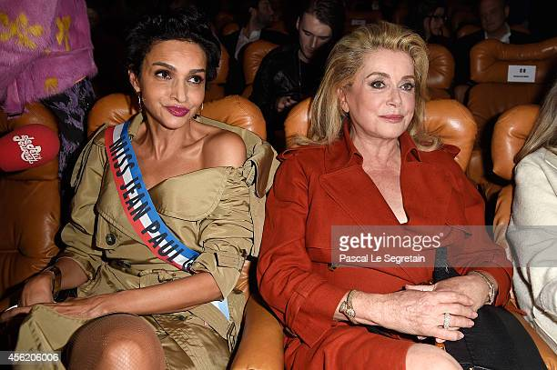 Farida Khelfa and Catherine Deneuve attends the Jean Paul Gaultier show as part of the Paris Fashion Week Womenswear Spring/Summer 2015 on September...