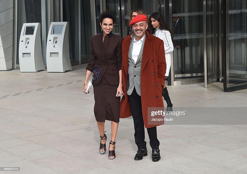 Farida Khelfa and Christian Louboutin attend the Louis Vuitton show as part of Paris Fashion Week Fall Winter 2015/2016 on March 11 2015 in Paris...
