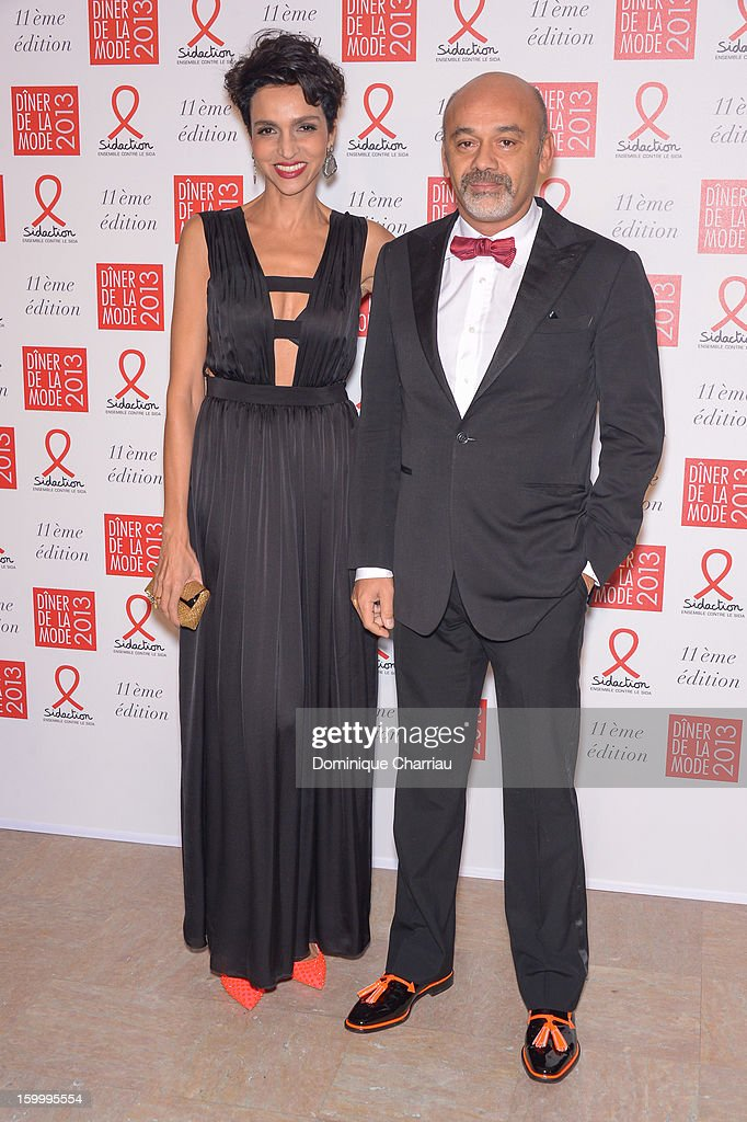 Farida Khelfa and Christian Louboutin attend the Sidaction Gala Dinner 2013 at Pavillon d'Armenonville on January 24, 2013 in Paris, France.