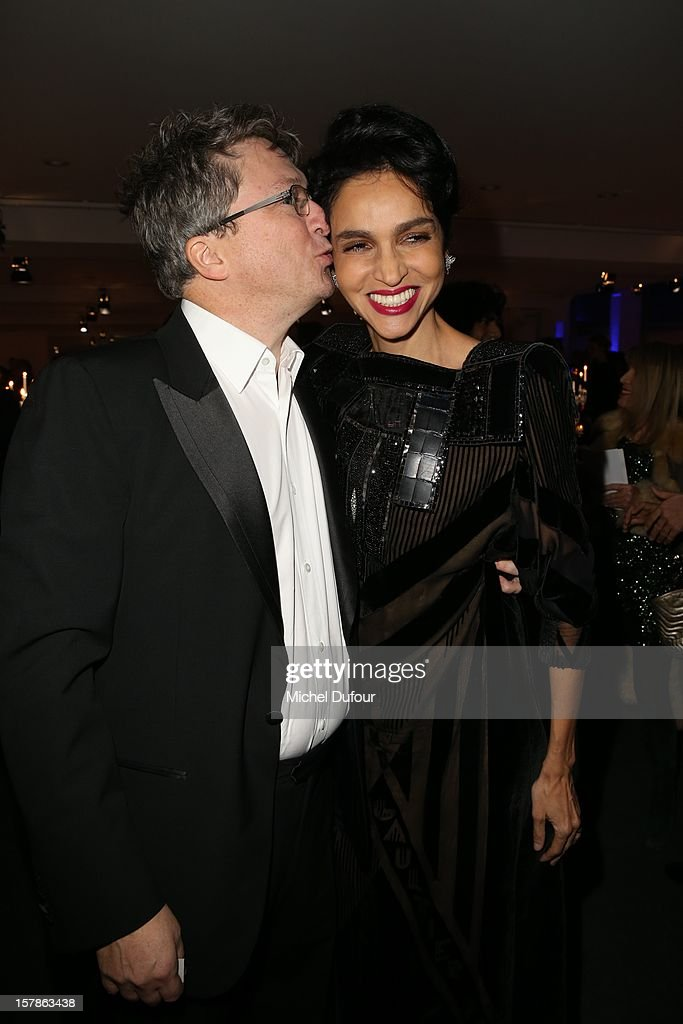 Farida Khelfa and Husband Henri Seydoux attend the Babeth Djian Hosts Dinner For Rwanda To The Benefit Of A.E.M. on December 6, 2012 in Paris, France.