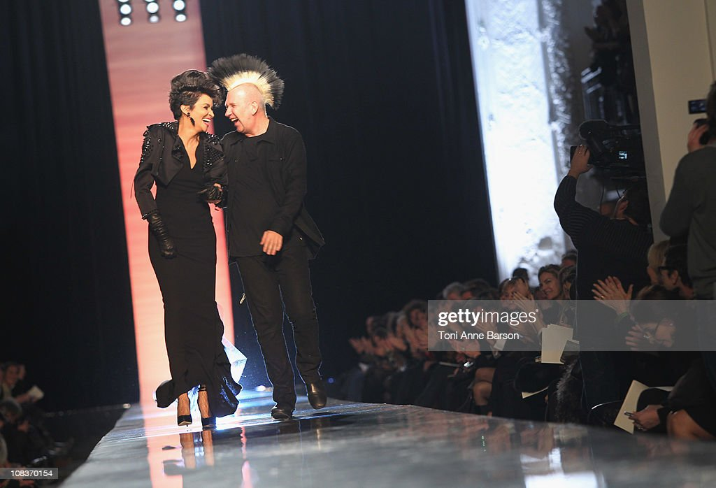 Farida Khelfa and JeanPaul Gaultier Walk the runway during the JeanPaul Gaultier show as part of the Paris Haute Couture Fashion Week Spring/Summer...